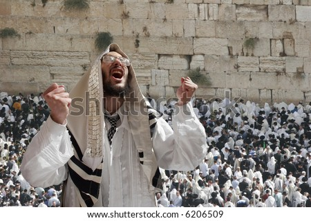 Israelite being passionately prayed in western wall. - stock photo