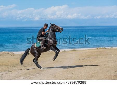 "Issyk-Kul, Kyrgyzstan - SEPTEMBER 15: National Games nomads ""Kokpar"" September 15, 2015 in Issyk-Kul, Kyrgyzstan - stock photo"