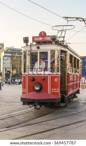 ISTAMBUL,TURKEY - JULY 09, 2014: The famous historical tram in the center of Istanbul's Taksim Square