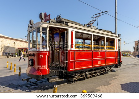 ISTAMBUL,TURKEY - JULY 11, 2014: The famous historical tram in the center of Istanbul's Taksim Square