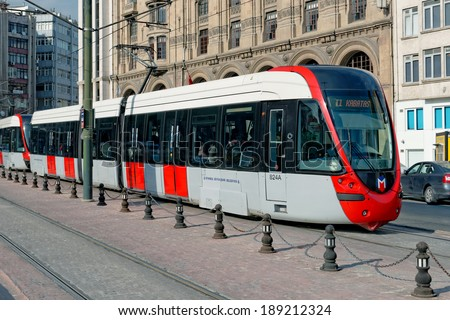 ISTANBUL - APRIL 20: A modern tram on Karakoy on April 20, 2014 in Istanbul. Due to increasing traffic & air pollution, Istanbul became one of most polluted city also planned for return of tram.  - stock photo