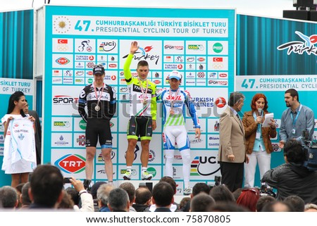 ISTANBUL - APRIL 24: Andrea Guardini, Tyler Farrar, Kenny Van Hummel and President Abdullah Gul pose after 1st Stage of 47th Presidential Cycling Tour of Turkey on April 24, 2011 in Istanbul, Turkey.