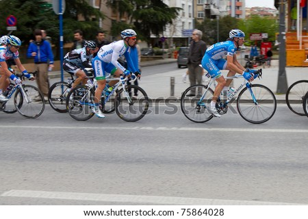 ISTANBUL - APRIL 24: Cyclists in action during the 1st stage of 47th Presidential Cycling Tour of Turkey on April 24, 2011 in Istanbul, Turkey.