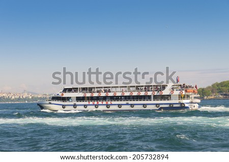 ISTANBUL - APRIL 29, 2014: Ferry boat at the golden horn, a horn-shaped estuary, and a major urban waterway. It is also the primary inlet of the Bosphorus.