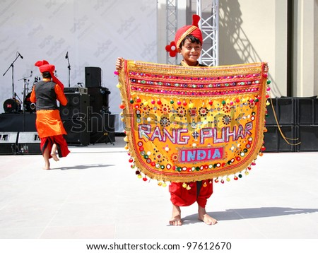 """ISTANBUL - APRIL 23: Unidentified 10 years old Indian child in traditional costume performs during """"National Sovereignty and Children Day"""" festival at Maltepe University on April 23, 2010 in Istanbul. - stock photo"""