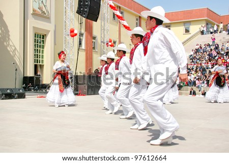 "ISTANBUL - APRIL 23: Unidentified 12 years old Mexican children in traditional costume perform folk dance during ""National Sovereignty and Children Day"" festival, April 23, 2010 in Istanbul. - stock photo"