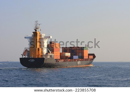ISTANBUL - AUG 12, 2013: Container Ship SEA PIONEER (IMO: 9319557, Malta) sailing into open sea. A 148 mt long, 23 mt width vessel, launched into the sea in 2005 and has a 14,003 DWT - stock photo