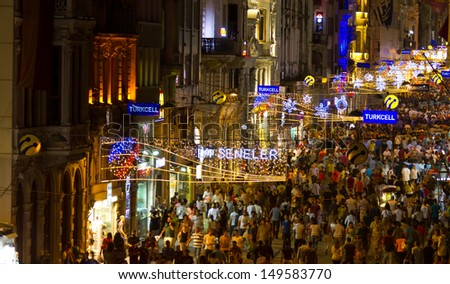 ISTANBUL, AUGUST 10 : People on Istiklal Street at night on August 10, 2013 in Istanbul, Turkey. Istiklal Street is the most popular destination of Istanbul for shopping and entertainment.