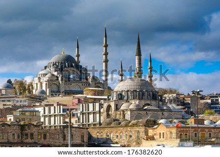 Istanbul cityscape on a sunny day, view from Galata bridge, with 2 beautifull mosque and its impresive minarets - stock photo