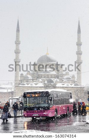ISTANBUL - JAN 30: City IETT bus about to leave at Eminonu on January 30, 2012 in Istanbul. IETT is main bus operator. It uses a fleet of more than 2600 buses and serves about 1,3 million rides daily - stock photo