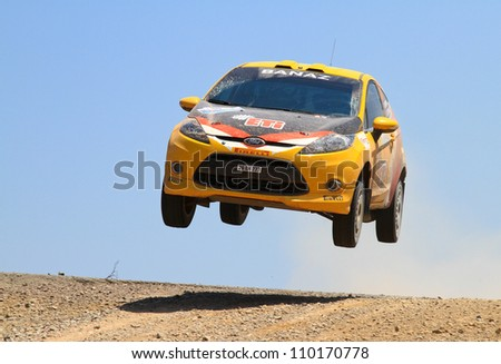 ISTANBUL - JULY 07: Bugra Banaz drives a Ford Fiesta R2 car during 41st Bosphorus Rally ERC Championship, Halli Stage on July 7, 2012 in Istanbul, Turkey. - stock photo