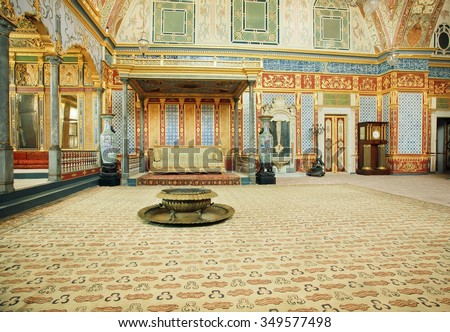 ISTANBUL - JULY 22: Imperial Hall and the throne of Sultan with historical interior of Topkapi palace on July 22, 2015 in Turkey. Great example of palaces of Ottoman period, UNESCO World Heritage Site - stock photo