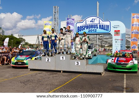 ISTANBUL - JULY 08: Juho Hanninen(1st), Yagiz Avci(2nd), Luca Rossetti(3rd) at podium of 41st Bosphorus Rally ERC Championship on July 8, 2012 in Istanbul, Turkey.