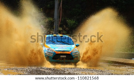 ISTANBUL - JULY 08: Ozcan Soke drives a Ford Fiesta R2 car during 41st Bosphorus Rally ERC Championship, Deniz Stage on July 8, 2012 in Istanbul, Turkey. - stock photo