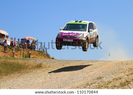 ISTANBUL - JULY 07: Ozgur Gur drives a Team 47 Motorsports team Ford Fiesta St car during 41st Bosphorus Rally ERC Championship, Halli Stage on July 7, 2012 in Istanbul, Turkey. - stock photo