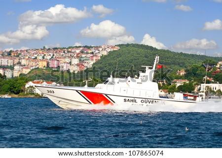 ISTANBUL - JULY 5: Turkish coast guard boat TCSG-303 on July 5, 2012 in Istanbul. A 25 mt long, 7 mt width law enforce vessel, has a maximum speed of 41 knots. - stock photo