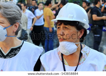 ISTANBUL - JUN 17: Labor unions call 1-day nationwide strike over crackdown on June 17, 2013 in Istanbul,Turkey. Human rights members wearing white helmet, monitor possible abuses during demonstration