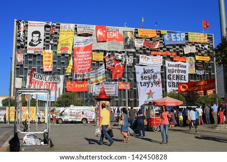 ISTANBUL - JUN 10: Plans to build on Gezipark led to anti government unrest on June 10, 2013 in Istanbul, Turkey. A festival atmosphere prevailed on fourteenth days of protest at Taksim Square - stock photo