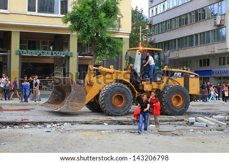 ISTANBUL - JUN 12: Plans to build on Gezipark led to anti government unrest on June 12, 2013 in Istanbul, Turkey. Workers clean Taksim Square after the overnight crackdown on sixteenth days of protest - stock photo