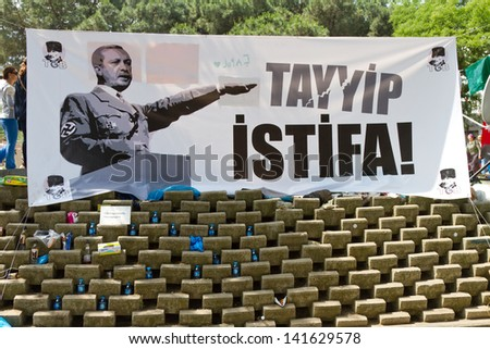 ISTANBUL - JUNE 08: A street banner in Gezi Park on June 08, 2013 in Istanbul, Turkey. Clashes are one of the most challenging events for Prime Minister Recep Tayyip Erdo���°an's ten-year rule - stock photo
