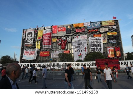 ISTANBUL - JUNE 06, 2013: Banners on AKM building at Taksim Square during protests in Istanbul, Turkey. Protest started 28 May against replacing Taksim Gezi Park to a mall and spread to the country.