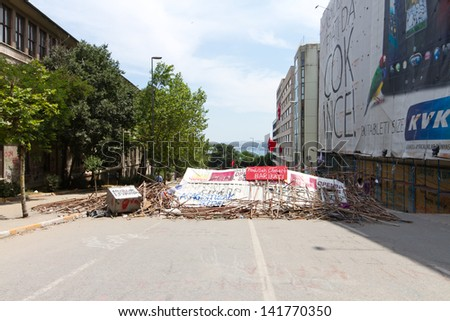 ISTANBUL - JUNE 08: Barricade around Taksim district during protests on June 08, 2013 in Istanbul, Turkey. People do not allow police to enter Taksim Square before their requests are accepted. - stock photo