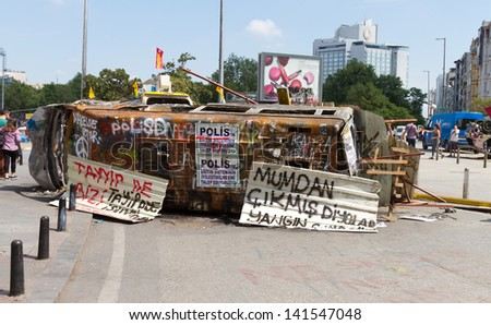 ISTANBUL - JUNE 08: Barricade by van around Taksim Square during protests on June 08, 2013 in Istanbul, Turkey. People do not allow police to enter Taksim Square before their requests are accepted. - stock photo