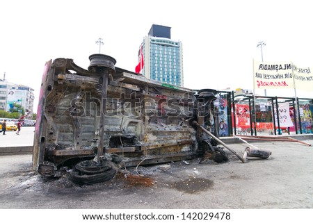 ISTANBUL - JUNE 08: Burned car during protests on June 08, 2013 in Istanbul, Turkey. Police used disproportionate force to protesters at Taksim in first three days. - stock photo