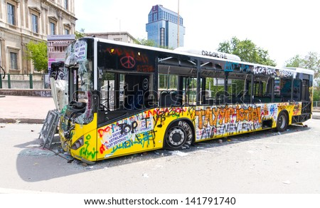 ISTANBUL - JUNE 08: Bus used as barricade around Taksim Square during protests on June 08, 2013 in Istanbul, Turkey.People don??t allow police to enter Taksim Square before their requests are accepted - stock photo