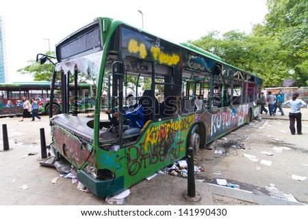 ISTANBUL - JUNE 08: Bus used as barricade around Taksim Square during protests on June 08, 2013 in Istanbul, Turkey. People dont allow police to enter Taksim Square before their requests are accepted - stock photo