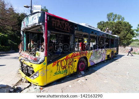 ISTANBUL - JUNE 08: Bus used as barricade around Taksim Square during protests on June 08, 2013 in Istanbul, Turkey. People dont allow police to enter Taksim Square before their requests are accepted