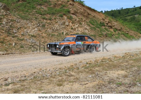 ISTANBUL - JUNE 04: Hannu Pulkkinen drives a  Ford Escort car during 40th Bosphorus Rally 2011 ER championship, Halli Stage on June 04, 2011 in Istanbul, Turkey - stock photo