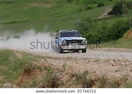 ISTANBUL - JUNE 04: Kemal Gamgam drives a 1979 Ford Escort Rs car during 40th Bosphorus Rally 2011 ER championship, Halli Stage on June 04, 2011 in Istanbul, Turkey - stock photo