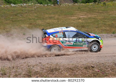 ISTANBUL - JUNE 04: Murat Bostanci drives a Castrol Ford Team Turkey Ford Fiesta S2000 car during 40th Bosphorus Rally 2011 ER championship, Darlik Stage on June 04, 2011 in Istanbul, Turkey - stock photo