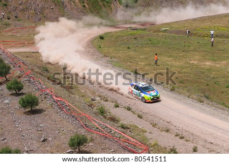 ISTANBUL - JUNE 04: Orhan Avcioglu drives a Castrol Ford Team Ford Fiesta R2 car during 40th Bosphorus Rally 2011 ER championship, Darlik Stage on June 04, 2011 in Istanbul, Turkey - stock photo