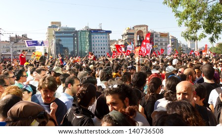 ISTANBUL - JUNE 01: People are at Taksim Square to protest against replacing Taksim Gezi Park on June 01, 2013 in Istanbul, Turkey. Protests developed into antigovernment demonstrations - stock photo