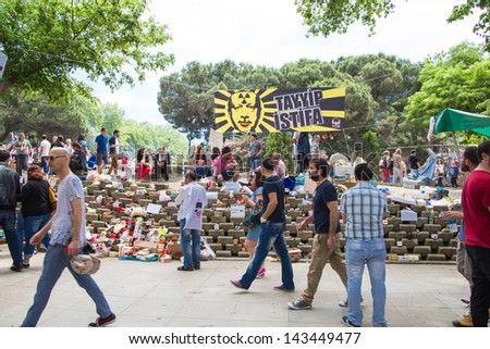 ISTANBUL - JUNE 06, 2013: People in Gezi Park during protests at Taksim Square in Istanbul, Turkey. Protest started 28 May against replacing Taksim Gezi Park to a mall and spread to the country.