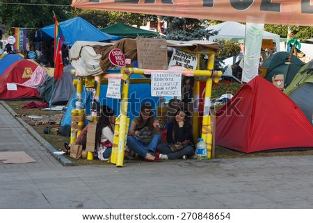 ISTANBUL - JUNE 10 2013 : People living in tents occupying Taksim square and Gezi Park.  - stock photo