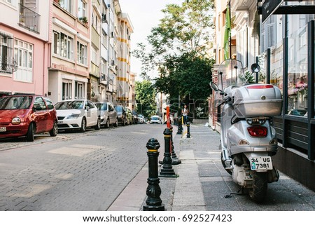Istanbul, June 14, 2017: Pespective view down the road on passage street with parked vehicles in Kadikoy district.