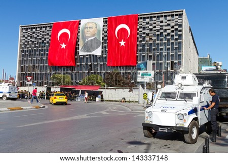 ISTANBUL - JUNE 22: Police force during protests in Turkey on June 22, 2013 in Istanbul, Turkey. Police intervened to people on afternon of June 22, 2013. - stock photo