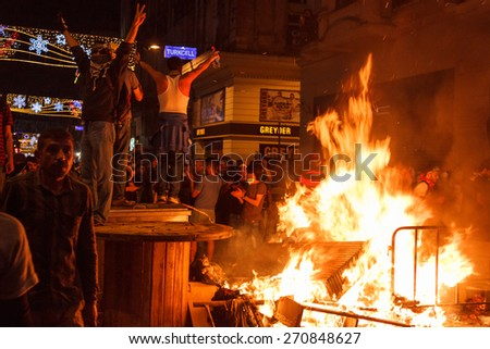 ISTANBUL - JUNE 15 2013 : Protesters fighting against tomas and trying to get in the Taksim Square.