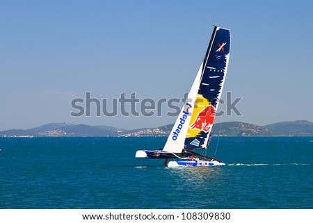 ISTANBUL - JUNE 09: Skipper Roman Hagara, Red Bull Sailing team boat competes in the Extreme Sailing Series, on June 09, 2012 Istanbul, Turkey. - stock photo