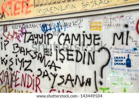 ISTANBUL - JUNE 06, 2013: Walls with slogans against government in Turkey during protests. Protest started 28 May against replacing Taksim Gezi Park to a mall and spread to the country. - stock photo