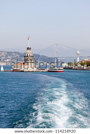 Istanbul Maiden Tower and away from the ferry - stock photo