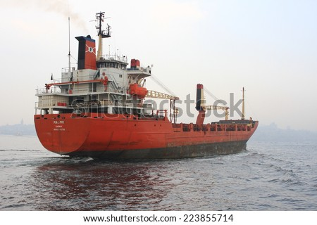 ISTANBUL - MAR 26, 2012: General cargo ship MALMO Zanzibar (Flag: Tanzania) heading towards open sea. 133 mt long, 20 mt width vessel, launched into the sea in 1982 and has a deadweight of 11,744 tons - stock photo