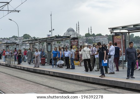 ISTANBUL - MAY 30: A modern tram on Sirkeci on May 30, 2014 in Istanbul. Due to increasing traffic & air pollution, Istanbul became one of most polluted city also planned for return of tram. - stock photo