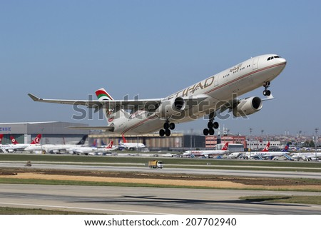 ISTANBUL - MAY 15: An Etihad Airbus A330 takes off on May 15, 2014 in Istanbul. Etihad is the flag carrier airline of the United Arab Emirates with its headquarters in Abu Dhabi. - stock photo