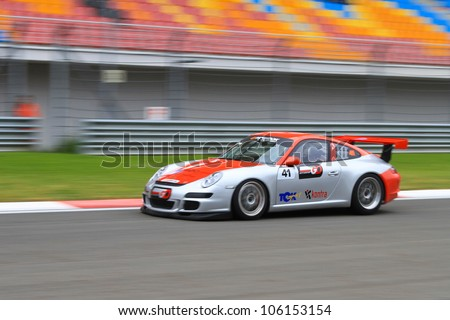 ISTANBUL - MAY 13: Emre Durmaz drives a Porsche 997 GT3 car during 2nd race of 2012 Vizio GT3 Challence, Istanbul Park on May 13, 2012 in Istanbul, Turkey. - stock photo