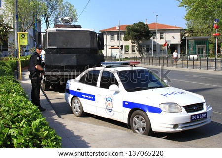 ISTANBUL - MAY 1: Many people can't take part in May Day march on May 1, 2013 in Istanbul. Police blocked all the ways to Taksim Square to prevent the activists from joining their mates. Police Car - stock photo