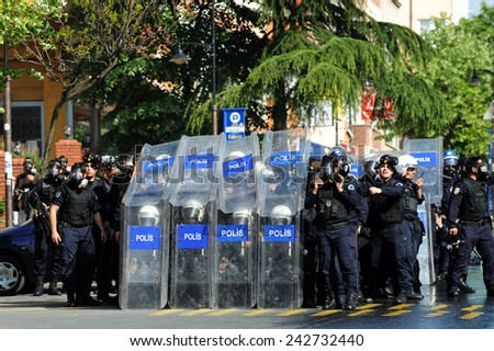 ISTANBUL - MAY 1: Many people can't take part in May Day march on May 1, 2009 in Istanbul. Police blocked all the ways to Taksim Square to prevent the activists from joining their mates. Policeman - stock photo